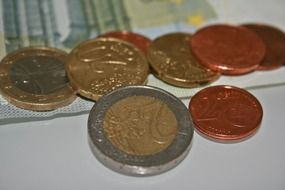 euro coins on euro bills
