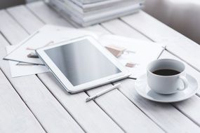 black coffee and white tablet