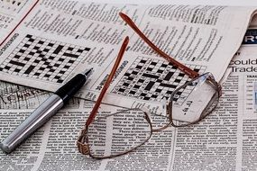 puzzling crossword in a newspaper