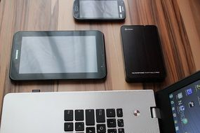 tablet smartphone laptop and hard drive on the table