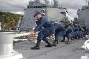 Photo of sailors teamwork