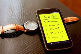 smartphone and watch with to do list