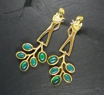 gold earrings with precious green stones