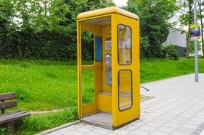 yellow phone booth in the park