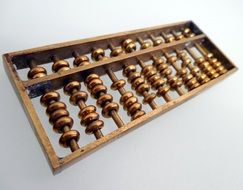 wooden abacus on a white surface