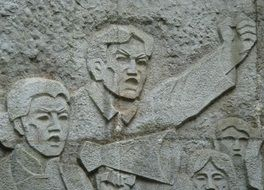 stone carving in the form of revolutionaries