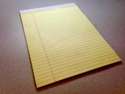 notepad with yellow paper