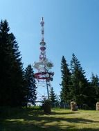 Photo of transmission tower on a hill