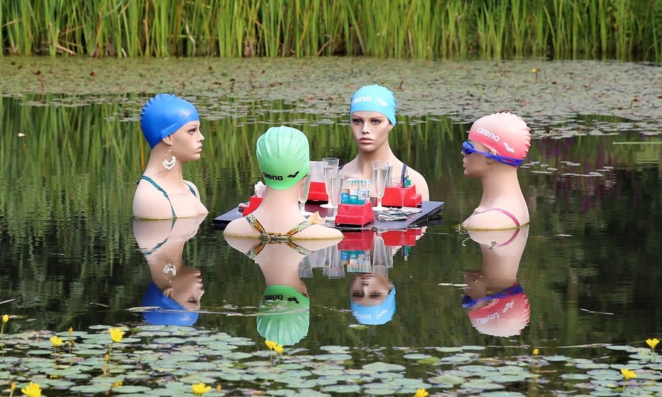 mannequins in a pond