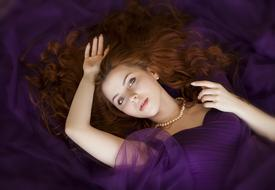 photo of red-haired girl in a purple dress