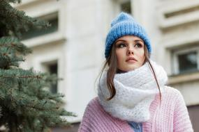 Portrait of young girl in hat and scarf outdoor