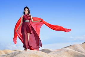 young asian Woman in Red clothe walking on sand Desert