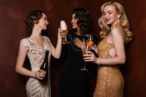 Three young sexy girls with champagne