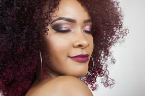 photo of a woman with eggplant curly hair