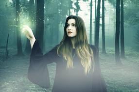 photo of a girl in a witch costume in the forest