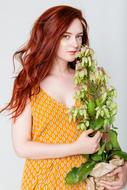 Young red haired Girl with potted plant