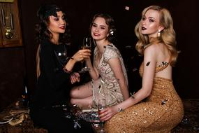 girls in beautiful retro dresses at a party