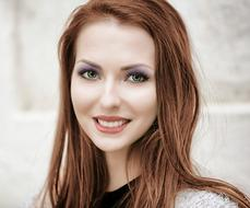 Portrait of pretty red haired young girl