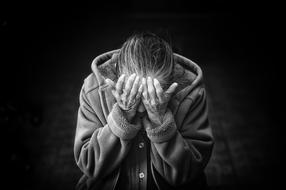 black and white photo of an elderly depressed woman