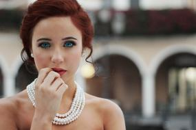 red hair woman with pearl necklace