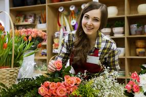 photo of a seller girl in a flower shop