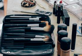 brushes and cosmetics on the table