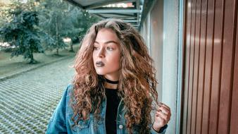 curly woman with dark lipstick