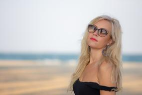 blonde in sunglasses on the beach