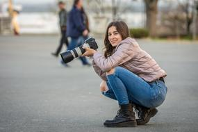 photographer, happy young girl in winter clothing