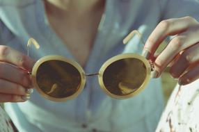 cool vintage Sunglasses in female hands