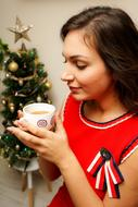 Christmas Mood, Girl with hot drink in cup at decoration