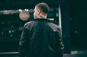 Man in back leather jacket