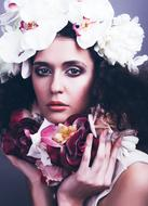 Glamour portrait, girl in floral headdress and scarf