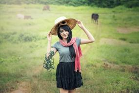 Woman hat Green grass