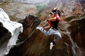 woman jumping in gorge