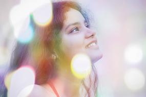happy woman portrait with bokeh effect