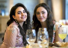 photo of two girlfriends in a restaurant
