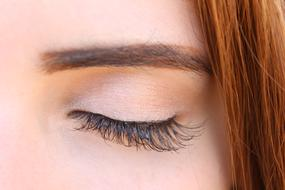 woman's eye with lush extension