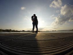 Couple is kissing on the pier
