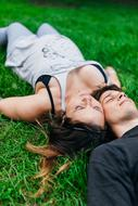 Couple Laying Grass green