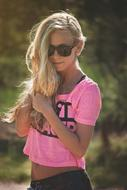 blonde in pink t-shirt