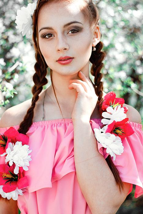 photo of a girl in a pink dress and flowers in her hair