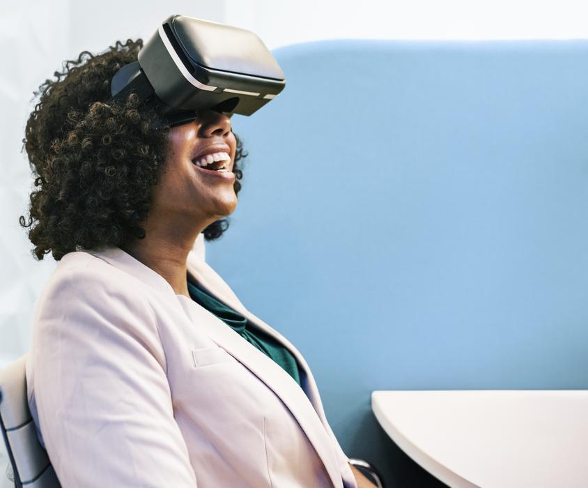 dark-skinned girl with virtual reality glasses