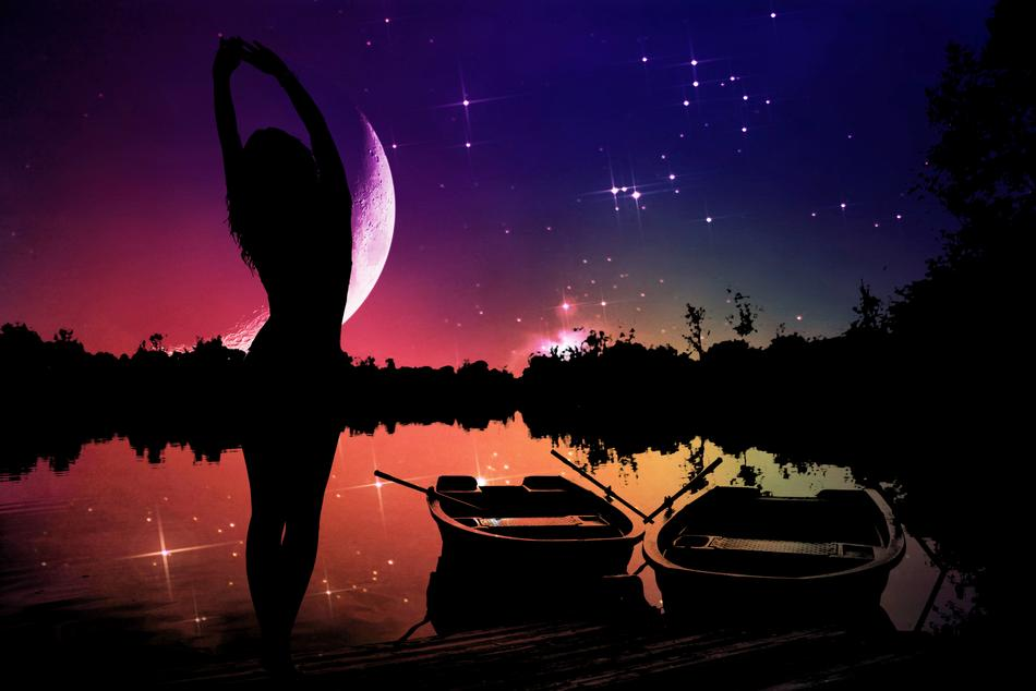 silhouette of a girl and fishing boats on the lake against the starry sky