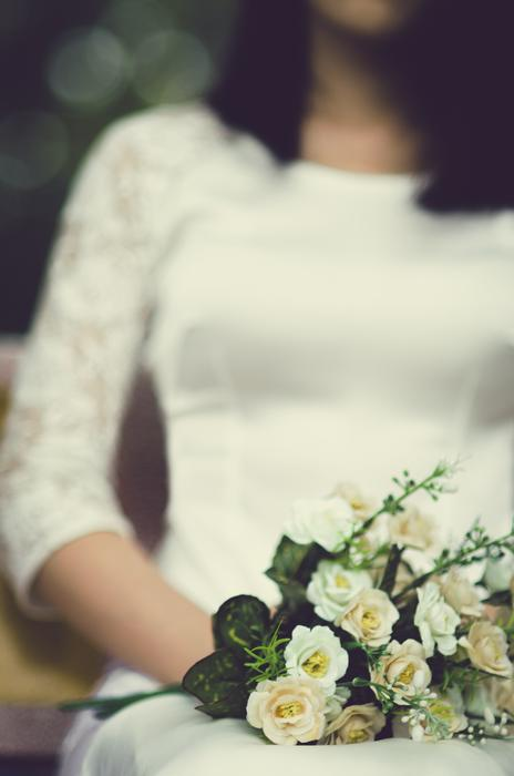 Bride in white dress and with white flowers in Hanoi Vietnam