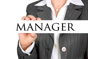 Manager, board in hand of Businesswoman