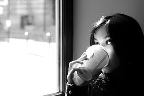 melancholic woman drinking coffee