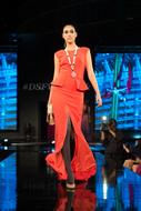 Fashion Show, model in red dress on Catwalk