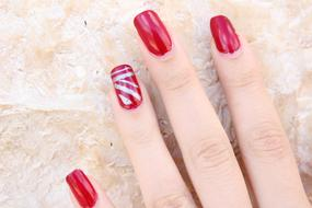 red manicure with a pattern