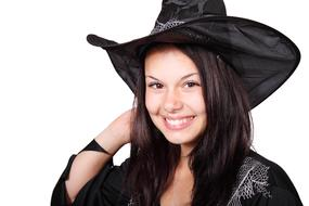 young woman in witch costume for Halloween